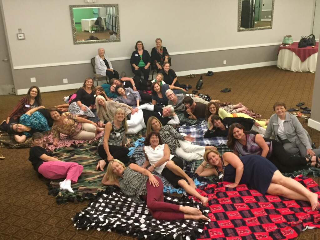 "We made ""no sew"" blankets for the OCC CARE Program at our first program meeting"